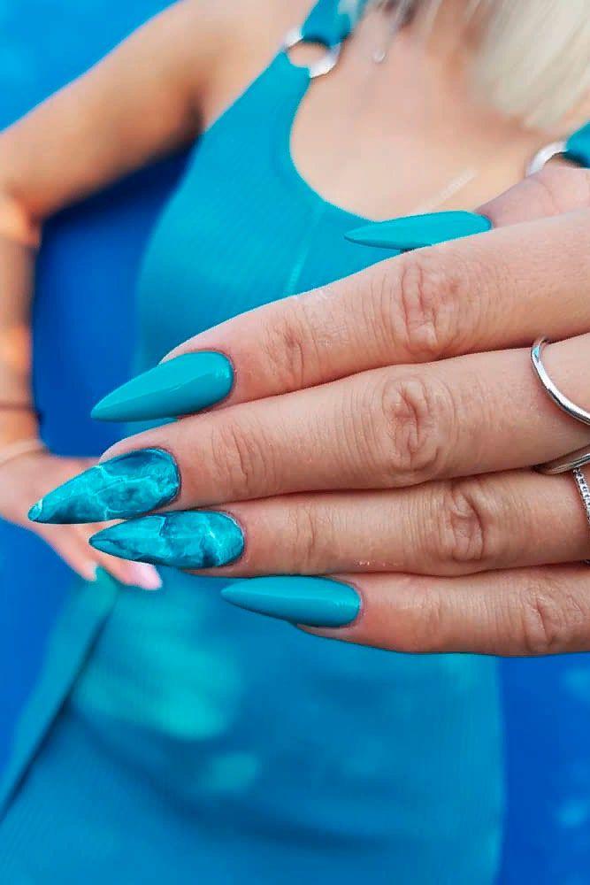 Turquoise Stilettos #stilettonails #turquoisenails