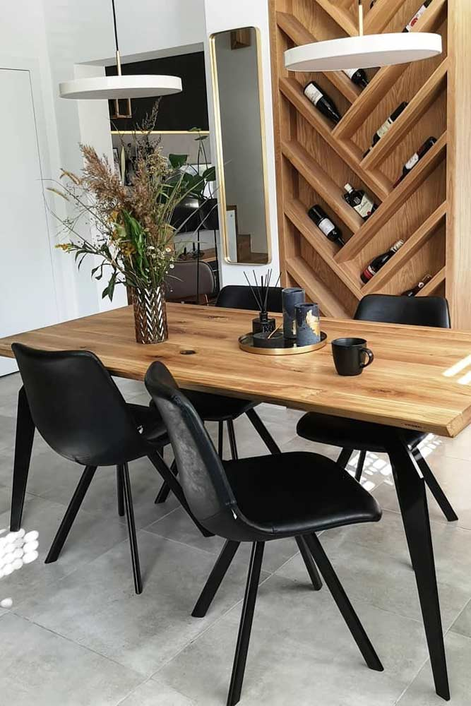 Industrial Dining Room With Wooden Wall Accent #industrialstyle #wallshelves