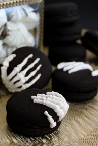 Black Macaroons With Skeleton Hands
