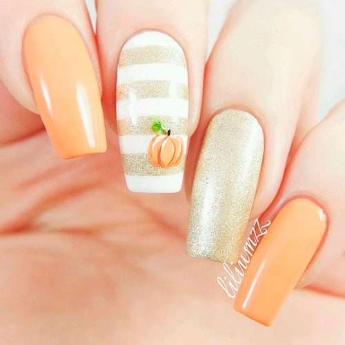 Elegant Nail Art With Gold Glitter And Tiny Pumpkin