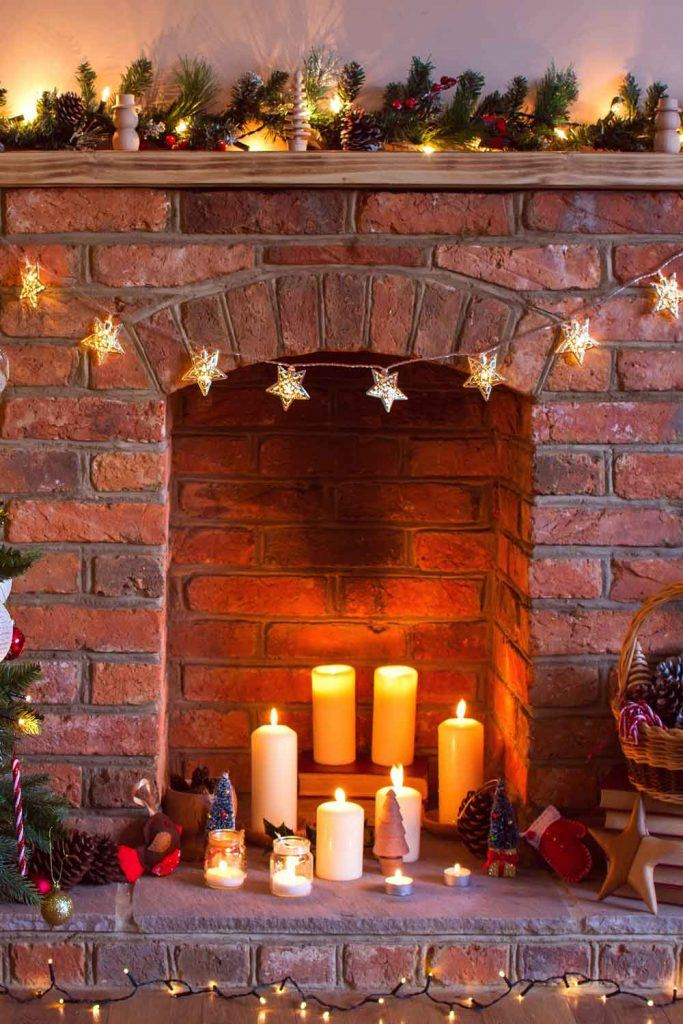 Christmas Fireplace Decor with Garlands and Candles