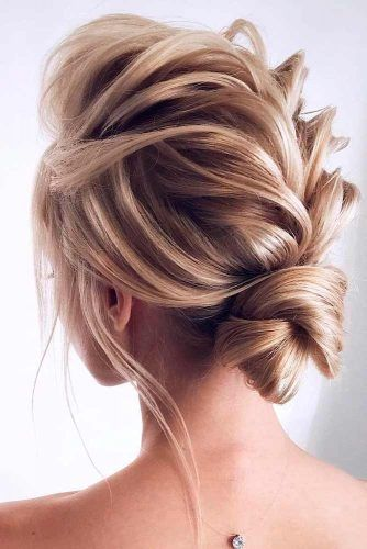 A Little Bit Messy Low Bun #bunhairstyles #massyhairstyles