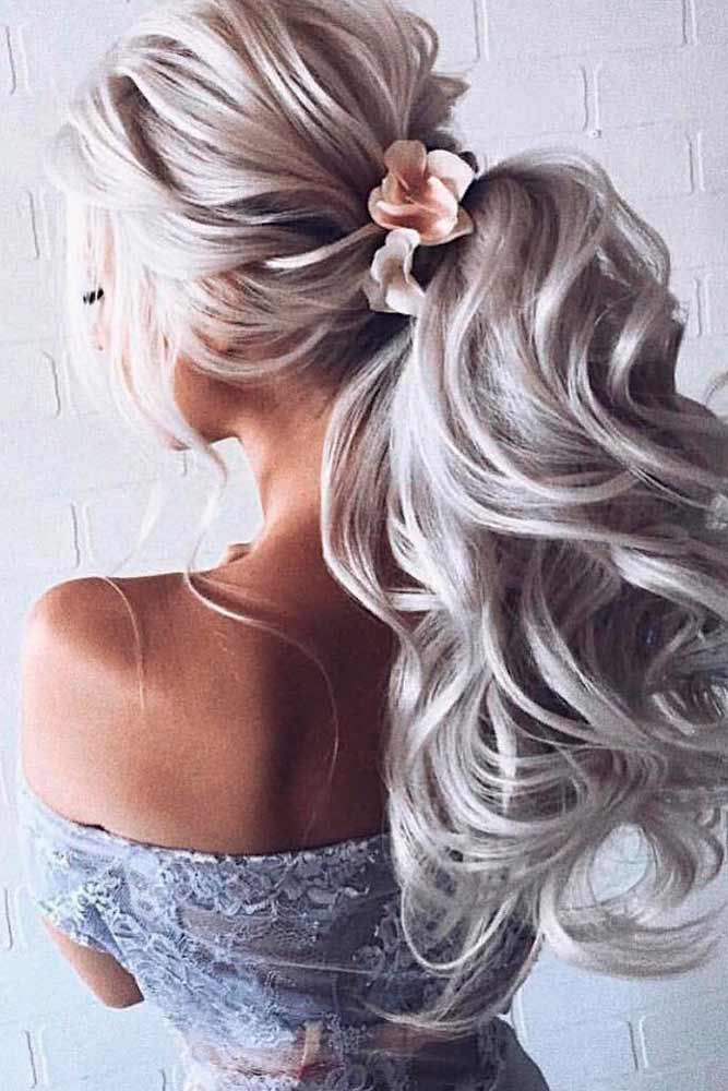 Wedding Ponytail With Flowers #flowershair #formalhairstyles #weddingponytails