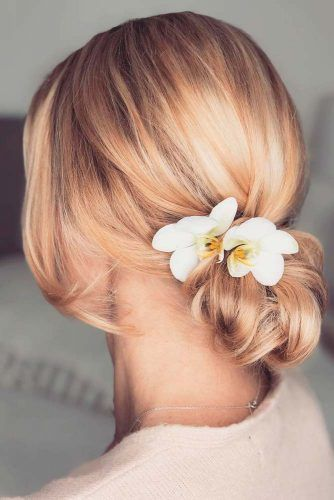 Easy Low Bun With Flowers #bunhairstyle #flowershair
