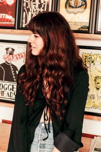 6. Messy Loose Curls with Thick Fringe
