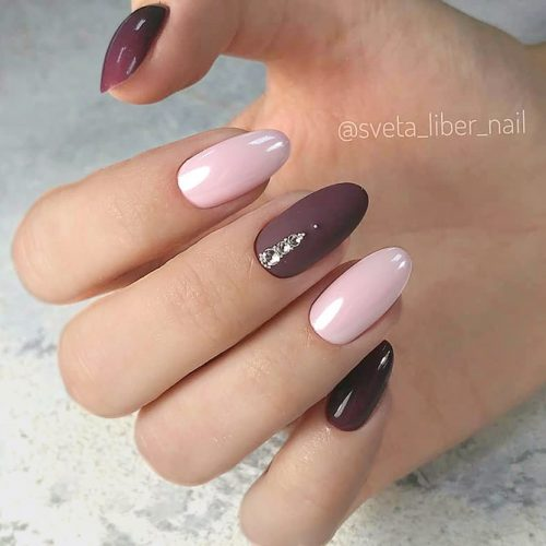 Delicate Manicure Ideas With Gorgeous Burgundy Accents For Homecoming Event #ovalnails #longnails #rhinestonesnails #nudenails #burgundynails