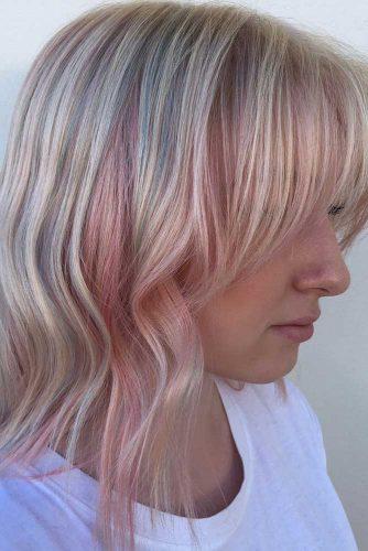 Blonde Layered Hair with Pastel Pink Locks