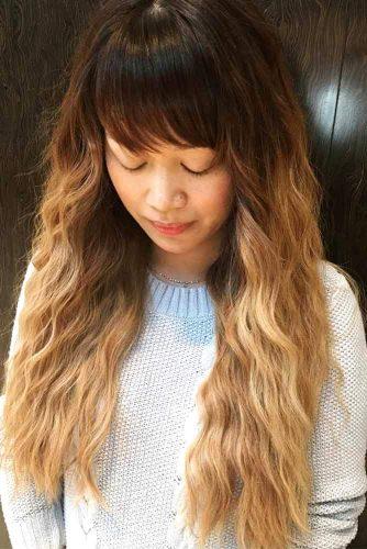 Long Wavy Haircut with Bangs