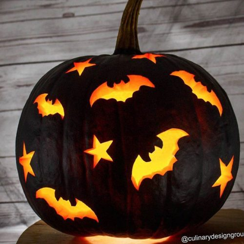 Black Pumkin Carving Idea With Bats