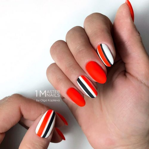 Red Nail Design With White And Black Stripes
