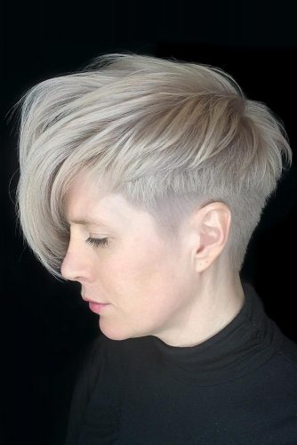 Fade Haircut With Pixie Hairstyle For Blondes #fadehaircutwomen #fadehaircutwomennaturalhair #fadehaircutwomendesigns #fadehaircutwomenundercut #fadehaircutwomenblonde