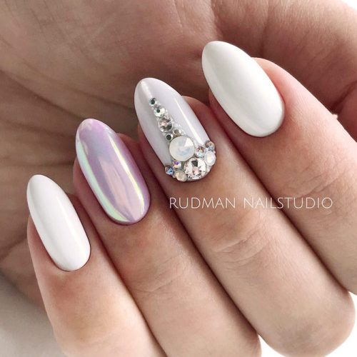 White Shellac Nails Designs With Rhinestones For A Classy And Elegant Look #whitenails #ovalnails #rhinestonesnails #chromenails