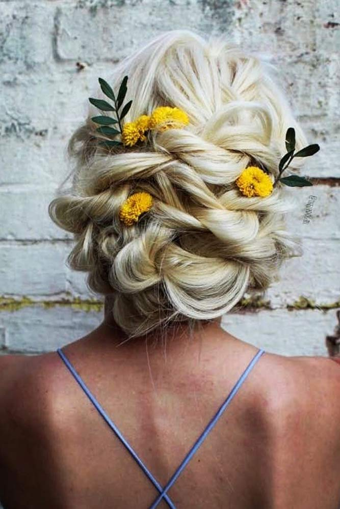 Blonde Chignon Hair Style With Yellow Flowers #flolralaccessory #blondechignon