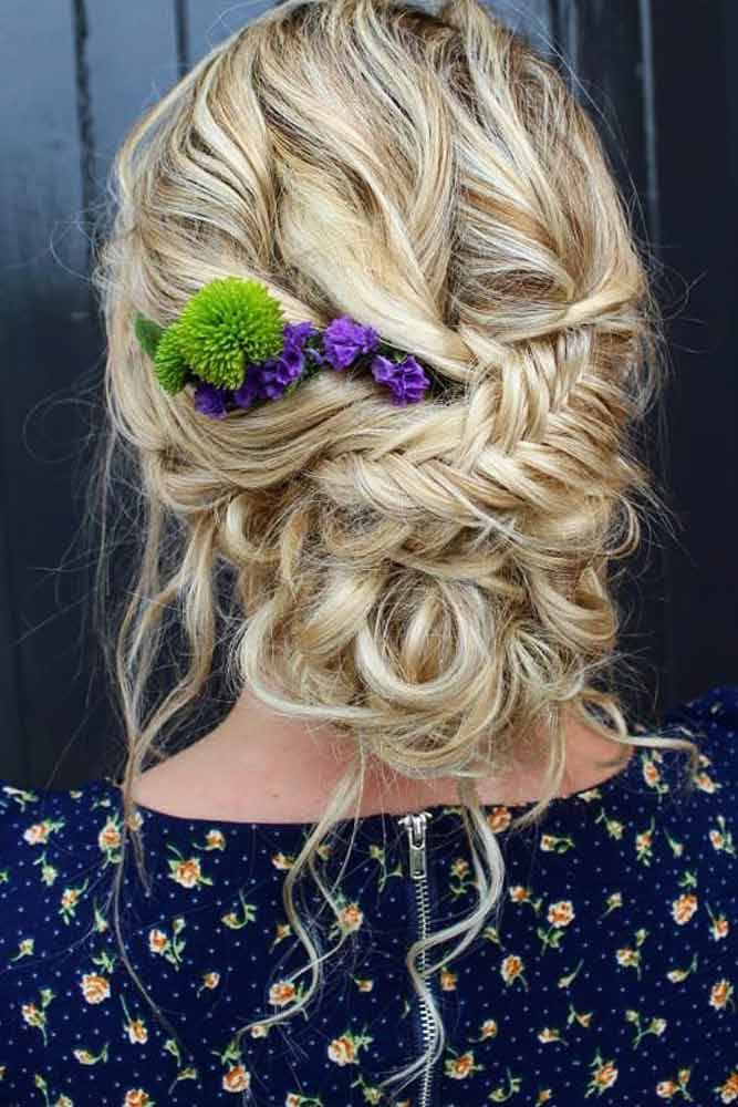 Chignon Hairstyle With A Floral Accessory #floralaccessory #fishtailbraid