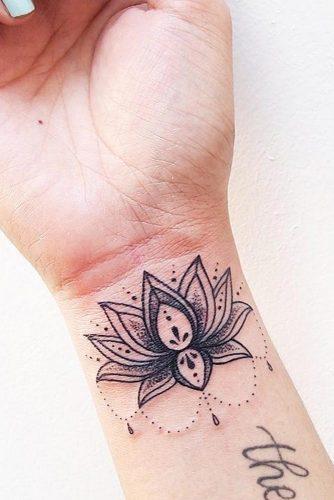 Beautiful Lotus Tattoo On A Wrist #wristtatto #blacktatto