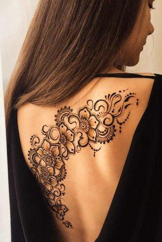 Back Henna Tattoo Design With Flowers #flowertattoo #backhennatattoo