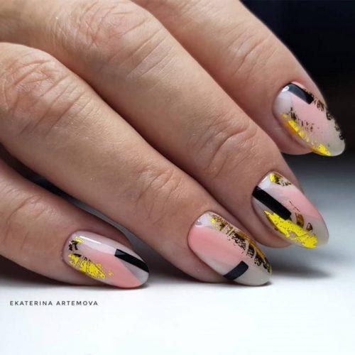 Oval Shaped Nails With A Bright Foil Design #foilnails #patternednails