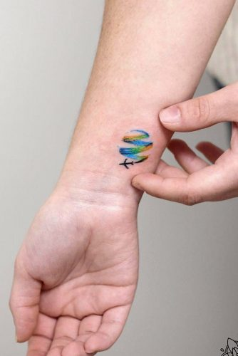 Small Wrist Tattoo Design With Plane For Travelers #planetattoo #traveltattoo