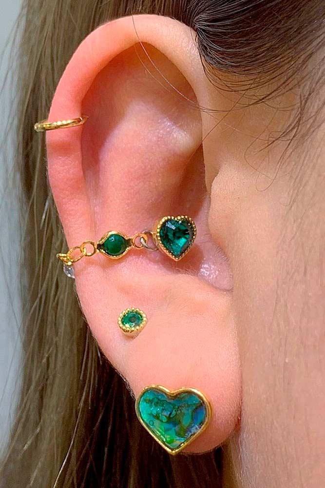 Conch Piercings With Green Stones #goldjewerly #conchpiercings