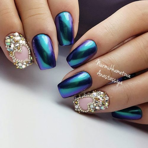 Bold Combination Of Chrome Nails And Crystal Accents #bluenails #chromenails #rhinestonesnails
