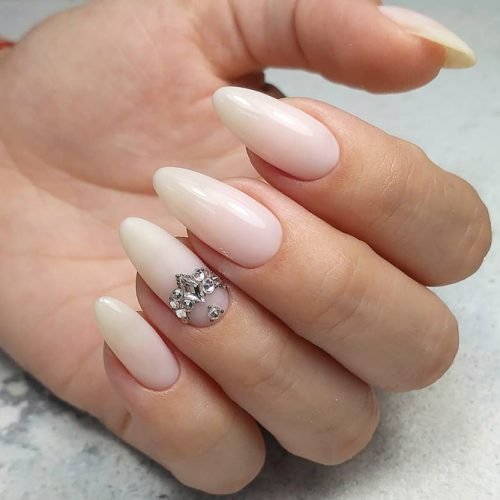Beautiful Nude Almond Nails With Rhinestones #nudenails #almondnails #rhinestonesnails