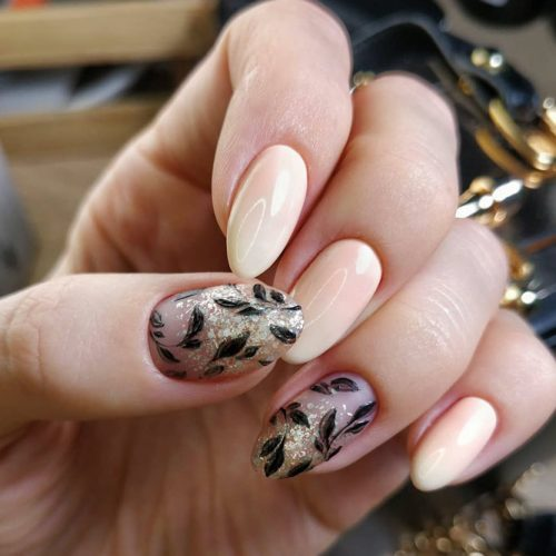 Fancy Nails With Black Floral Design #beigenails #nudenails #ovalnails #glitternails #floralnails