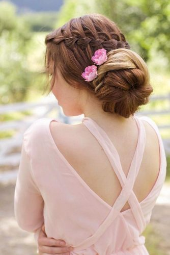 Waterfall Updo With A Floral Accessory #waterfallbraid #hairaccessory