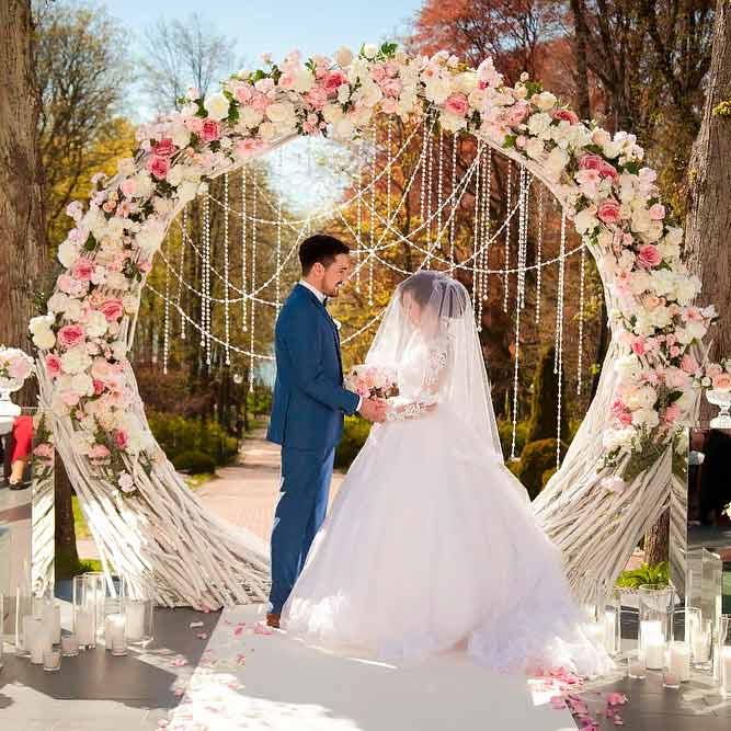 A Romantic Wedding Arch With Flowers And Beads #outdoorweddingarchway #flowersweddingarch