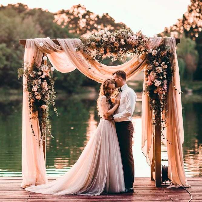 An Elegant Arch With Mixed Textures #outdoorweddingarch #weddingarchdraping