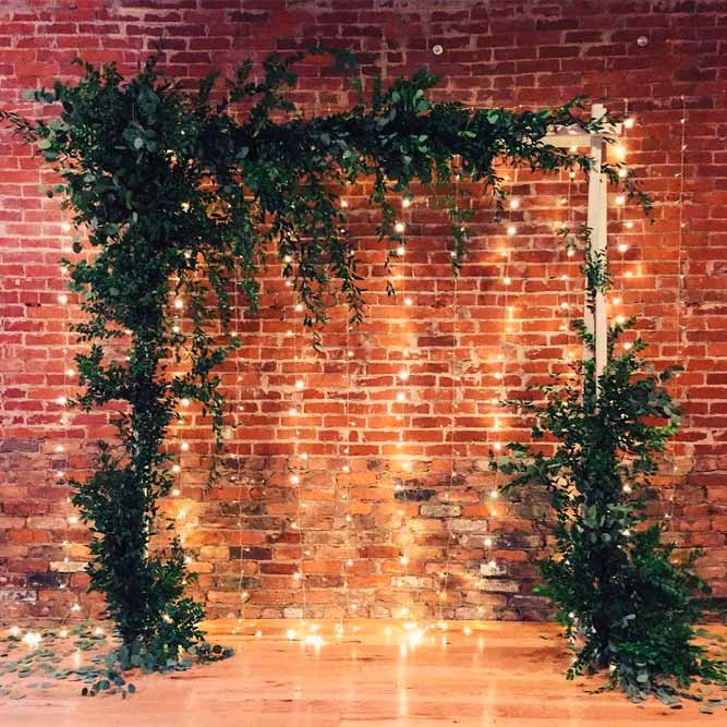 A Simple Idea With Greenery And Soft Lighting Backdrop #indoorarchway #simpleweddingarch