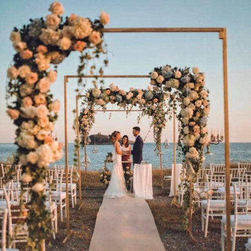 An Industrial Arch With Floral Accents #modernweddingarchway #flowersweddingarch