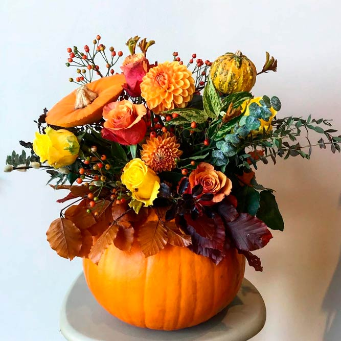 Fall Pumpkin Center Pieces #fallflowers #pumpkincenterpieces #fallcenterpieces