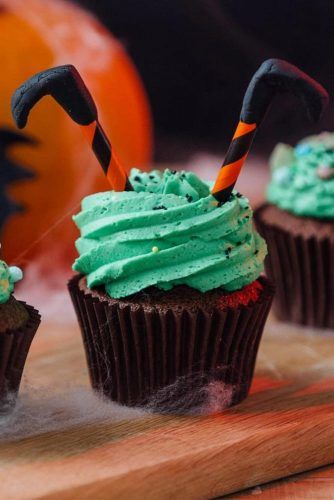 Halloween Cupcake Idea With Witch Legs Accent #witchlegs