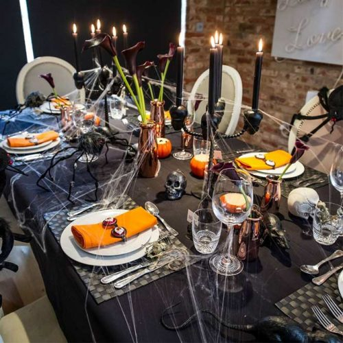 Vintage Halloween Table Setting With Webs And Flowers
