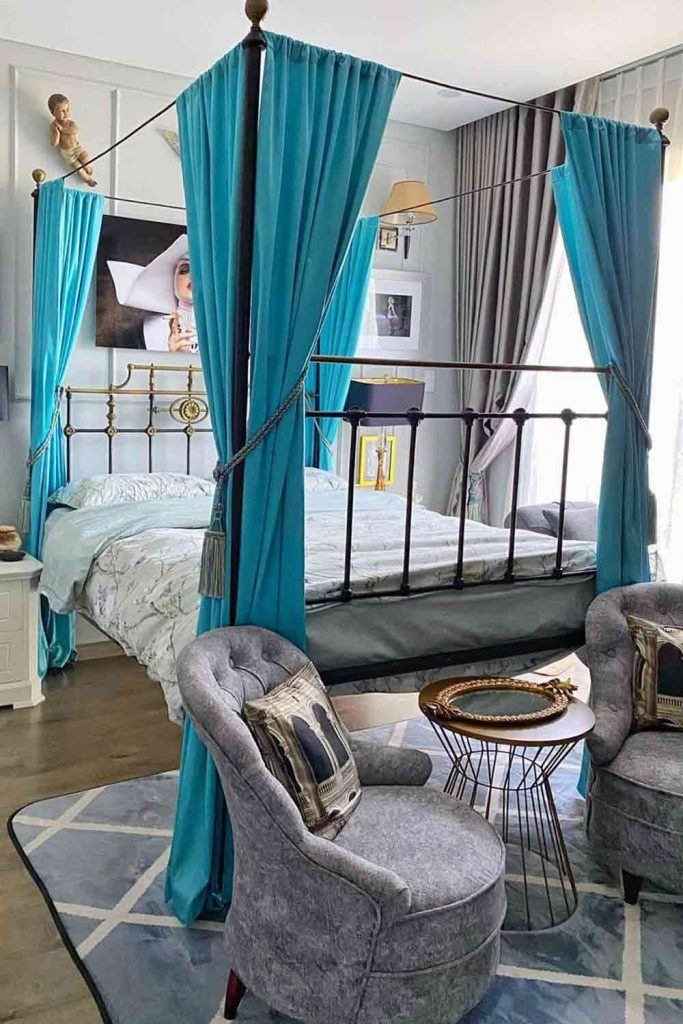 Metallic Vintage Canopy Bed With Blue Curtains #bluecurtains