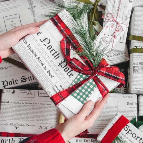 Newspaper Wrapping Paper With A Plaid Ribbon #plaidribbon #holidaywrapping