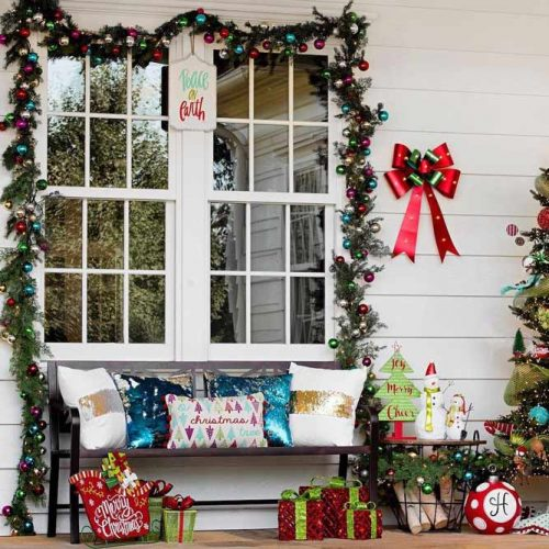 Front Porch Decorations With Sparkles And Bright Items #festivepillows #garland #balls