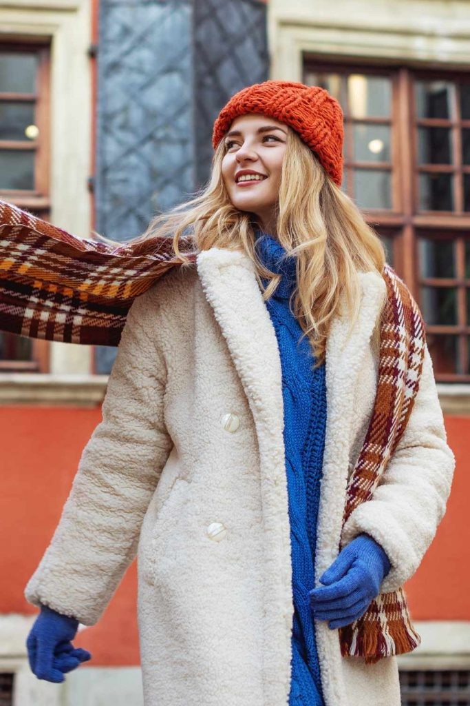 White Faux Fur Coat with Blue Sweater