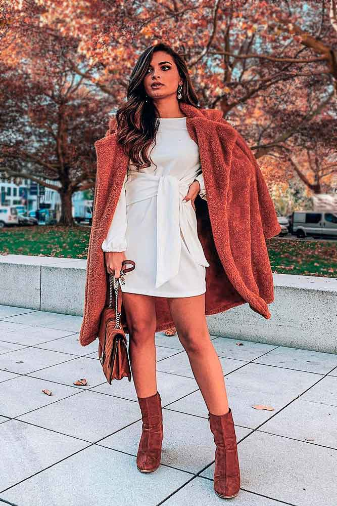 Red Outfit Accented With White Dress #redcoat #furcoat #whitedress