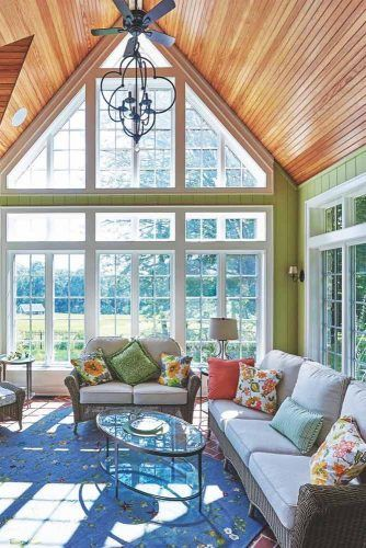 Sunroom With Dramatic Peaked Roof #wood #patternedpillows