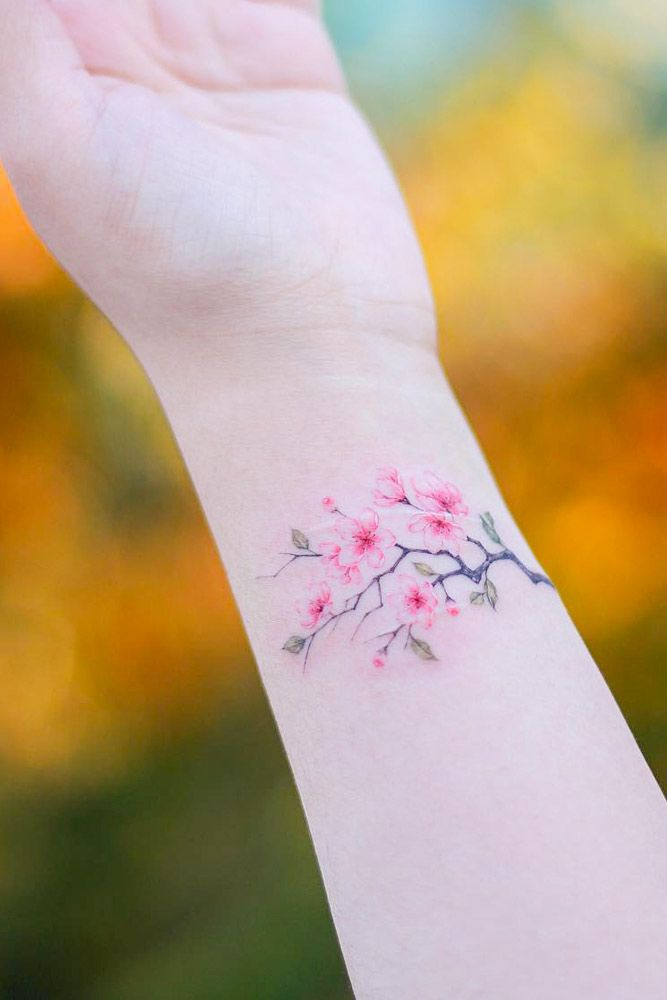 Cherry Blossom Branch Tattoo On Wrist #wristtattoo #cherryblossombranch #branchtattoo