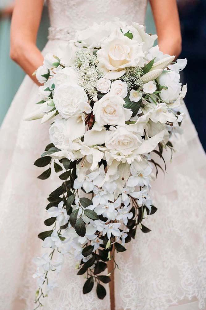 Charming And Elegant White Wedding Bouquet #weddingbouquet #whiteflowers