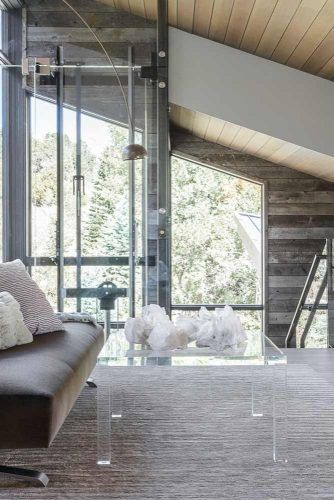 Modern Rest Space With Vaulted Ceiling And Large Windows #largewindows #woodenwalls