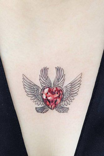 Crystal Heart Tattoo With Wings #sternumtattoo