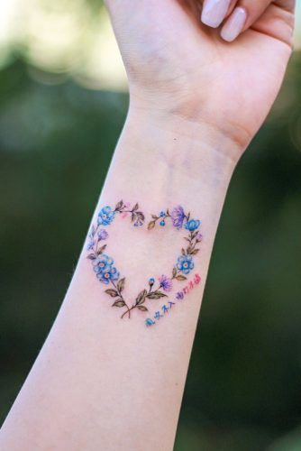 Flower Wreath With Heart Shape Tattoo #wristtattoo #floraltattoo