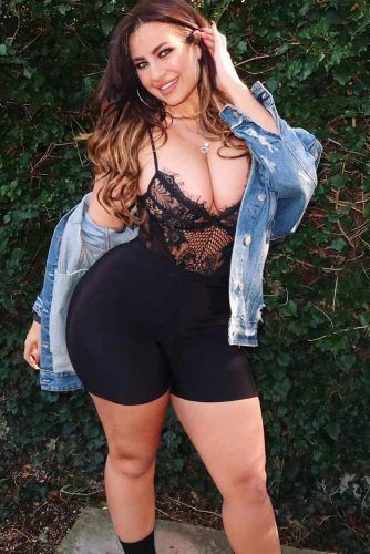 A Bike Shorts With A Lace Bodysuit Outfit #bikershorts #denimjacket