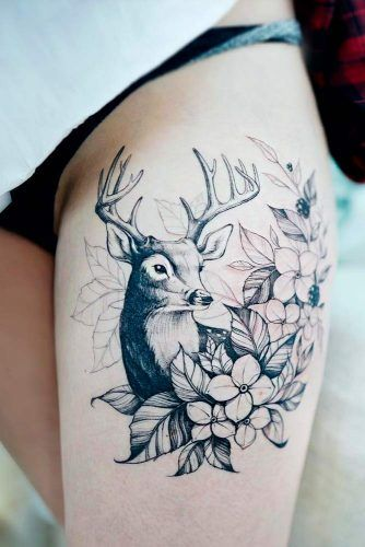 A Black And White Thigh Tattoo With A Deer #deertattoo