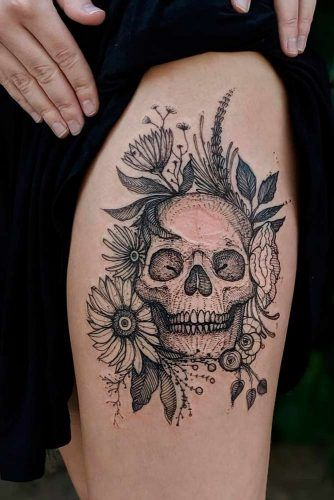 A Black And White Skull Tattoo Idea With Flowers #skulltattoo #floraltattoo