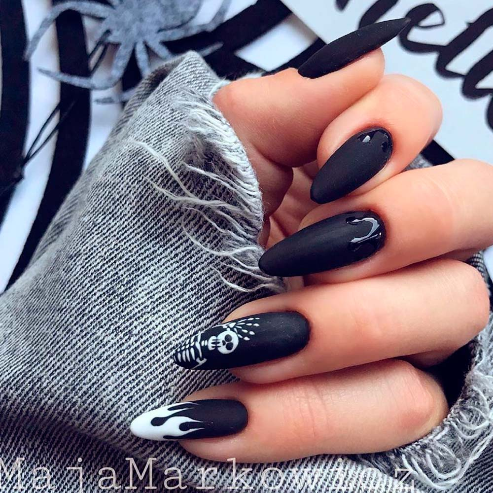 Dark Nail Art with Skull Accent