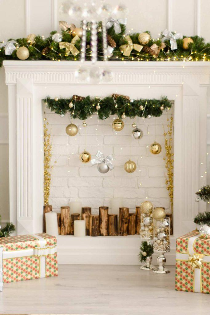 White Colored Fireplace with Garlands